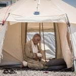 A wounded man prays in a tent in a UNHCR IDP camp outside of Mosul on June 5, 2017