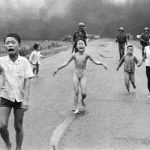 Phan Thi Kim Phuc running down a road near Trảng Bàng, Vietnam, after a napalm bomb was dropped on the village of Trảng Bàng by a plane of the Vietnam Air Force. The village was suspected by United States Army forces of being a Viet Cong stronghold. Kim Phúc survived by tearing off her burning clothes. Kim Phúc (aged 9; middle left) runs naked in the street. Also pictured is her older brother Phan Thanh Tam (aged 12; far left), younger brother Phan Thanh Phuoc (aged 5; background left, looking back) and younger cousins Ho Van Bo and Ho Thi Ting (boy and girl, respectively; middle right). The image above is an Associated Press photograph that won the Pulitzer Prize for spot news. It was taken by Nick Ut on June 8, 1972.
